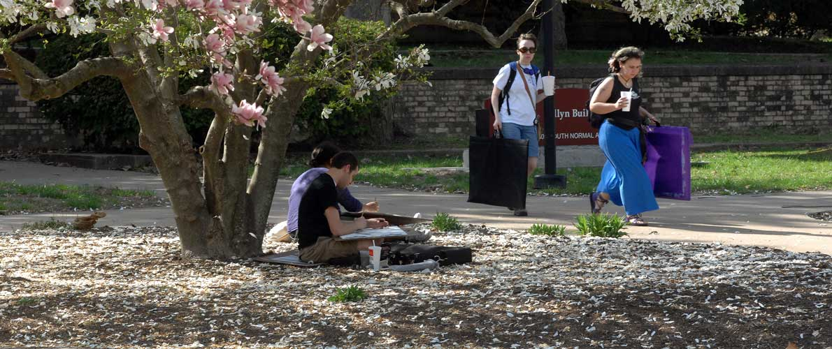 SIU students drawing under tree