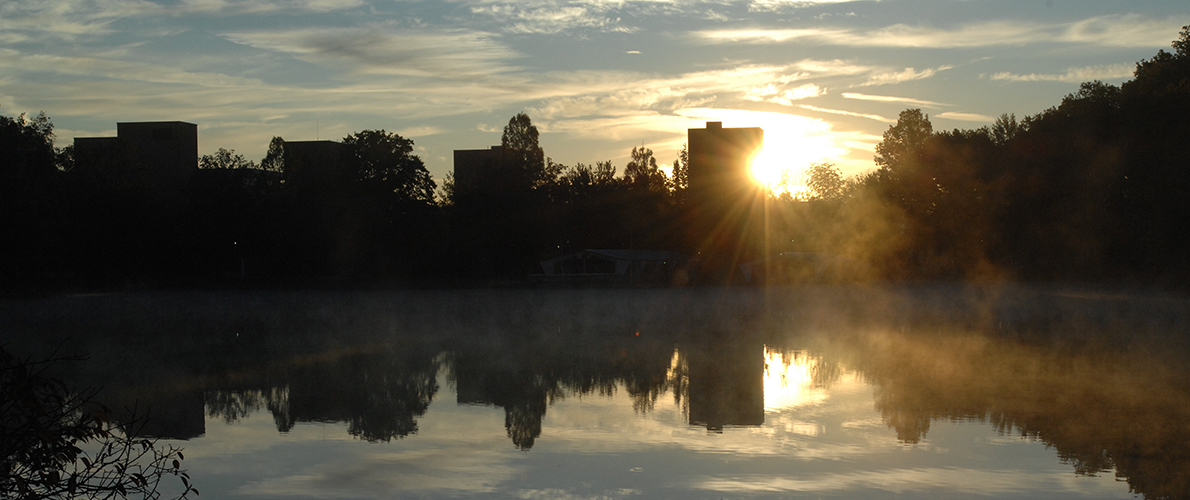 view of campus lake against sunset