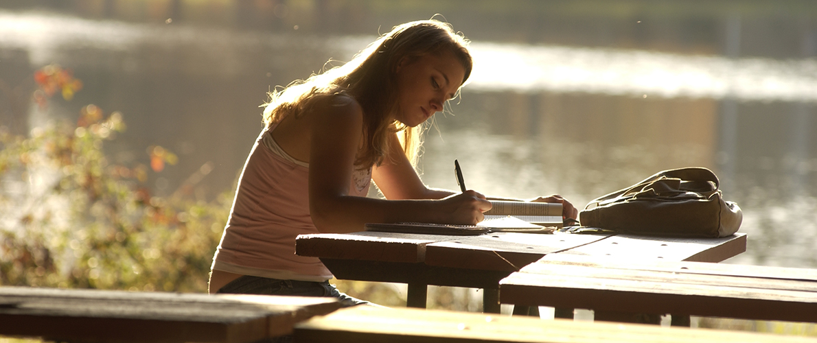 girl studying near Campus Lake
