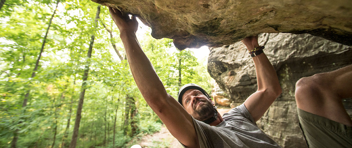 Male climbing a clif