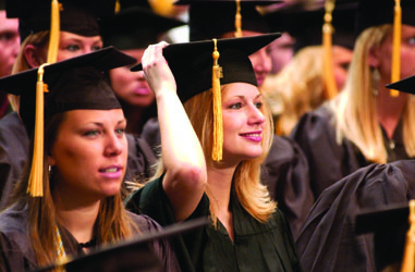 students at Commencement, in caps and gowns